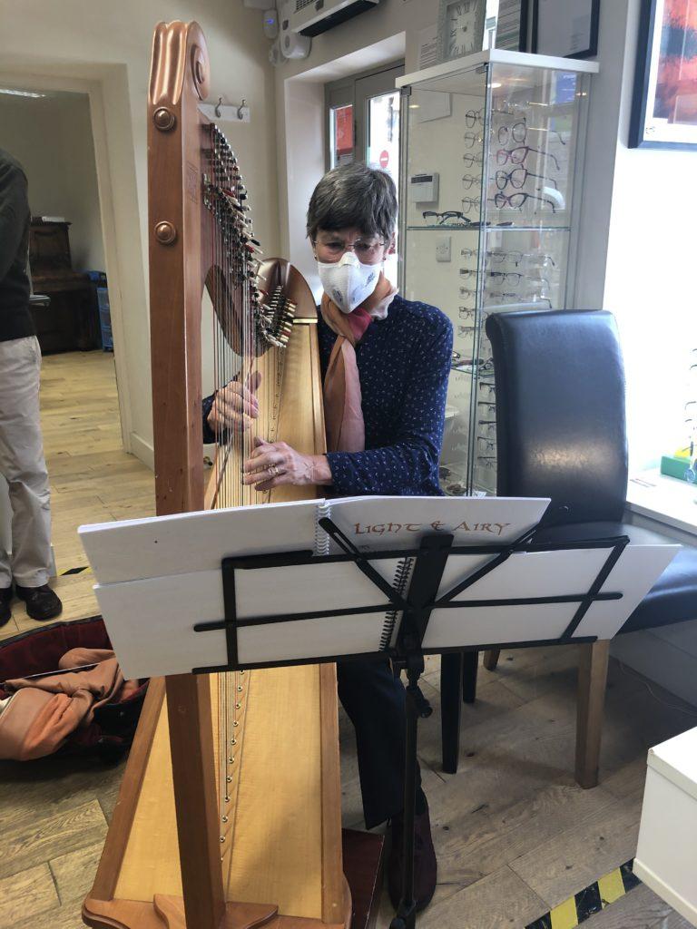Harpist Joan wears musicians glasses when playing her harp
